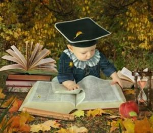 little-boy-with-many-books-in-autumnal-park-collage